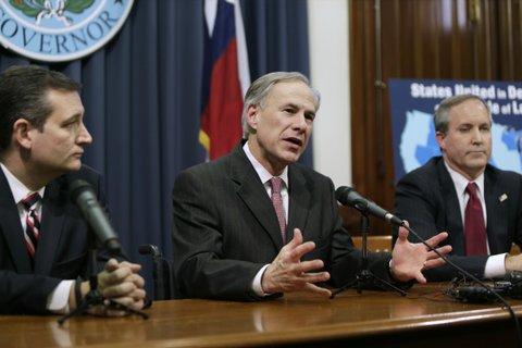 AUSTIN, TX -  FEBRUARY 18:  Governor Greg Abbott (C) speaks alongside U.S. Sen. Ted Cruz (R-TX) (L), Attorney General Ken Paxton (R) at a joint press conference February 18, 2015 in Austin, Texas.  The press conference addressed the United States District Court for the Southern District of Texas' decision on the lawsuit filed by a Texas-led coalition of 26 states challenging President Obama's executive action on immigration.  (Photo by Erich Schlegel/Getty Images)