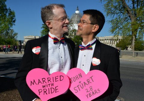A gay couple, John and Stuart from California, married from 28 years, pose outside the US Supreme Court waiting for its decision on April 28, 2015 in Washington, DC. The US Supreme Court is hearing arguments on whether gay couples have a constitutional right to wed -- a potentially historic decision that could see same-sex marriage recognized nationwide. AFP PHOTO / MLADEN ANTONOV (Photo credit should read MLADEN ANTONOV/AFP/Getty Images)