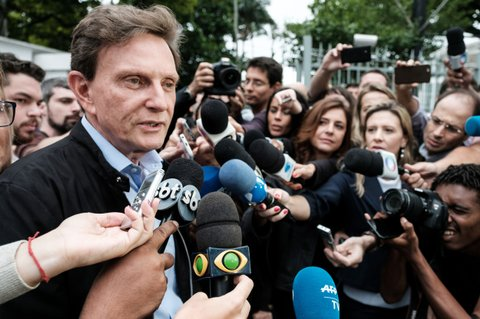 Rio de Janeiro's mayoral candidate for the Brazilian Republican Party (PRB) Marcelo Crivella speaks to the press after casting his vote at a polling station during the municipal election runoff in Rio de Janeiro, Brazil, on October 30, 2016. An evangelical mega-church bishop who once branded Catholics demons was expected to become mayor of Rio de Janeiro on Sunday in nationwide municipal elections confirming Brazil's shift to the right. / AFP / YASUYOSHI CHIBA        (Photo credit should read YASUYOSHI CHIBA/AFP/Getty Images)