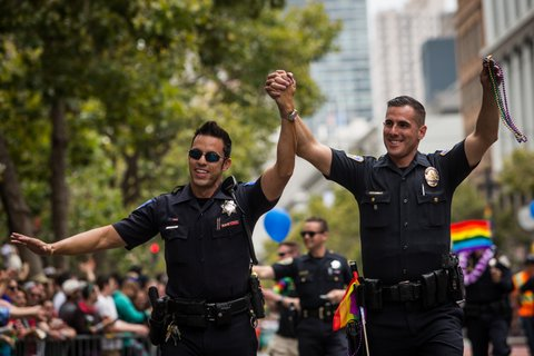SAN FRANCISCO, CA- JUNE 28: Sacramento Police Officer Jeff Kuhlmann, left, marches with his boyfriend, Los Angeles Police Officer David Ayala, right, in the San Francisco Gay Pride Parade, June 28, 2015 in San Francisco, California. The 2015 pride parade comes two days after the U.S. Supreme Court's landmark decision to legalize same-sex marriage in all 50 states. (Photo by Max Whittaker/Getty Images)