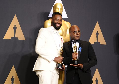 HOLLYWOOD, CA - FEBRUARY 26:  Screenwriter Tarell Alvin McCraney (L) and writer/director Barry Jenkins, winners of Best Adapted Screenplay for 'Moonlight', pose in the press room at the 89th annual Academy Awards at Hollywood & Highland Center on February 26, 2017 in Hollywood, California.  (Photo by Jason LaVeris/FilmMagic)