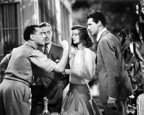 American film director George Cukor (1899 - 1983, left) directs actors (left to right) John Howard (1913 - 1995), Cary Grant (1904 - 1986) and Katharine Hepburn (1907 - 2003) during filming of 'The Philadelphia Story', 1940. (Photo by Silver Screen Collection/Getty Images)