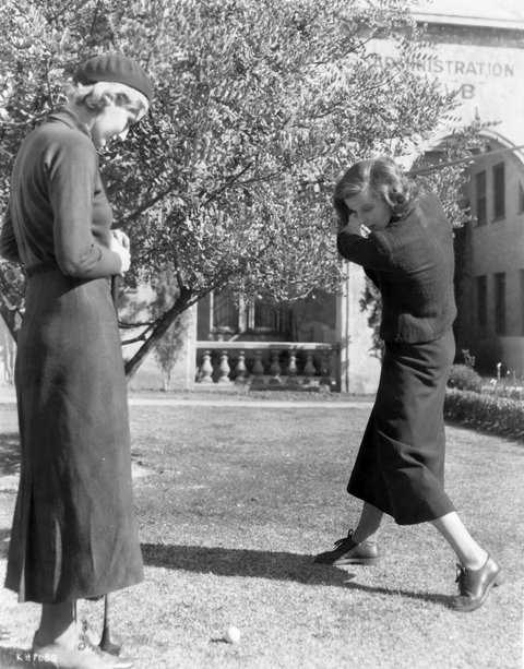 American actress Katharine Hepburn (1907 - 2003) plays a game of golf with a friend. (Photo by Hulton Archive/Getty Images)