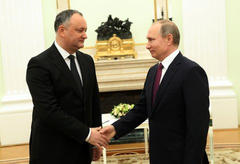 MOSCOW, RUSSIA - JANUARY 17: (RUSSIA OUT)  Russian President Vladimir Putin (R) shakes hands with Moldovan President Igor Dodon (L) during their meeting at the Kremlin on January 17, 2017 in Moscow, Russia. Newly elected President of Moldova Igor Dodon visits Russia for the first time. (Photo by Mikhail Svetlov/Getty Images)
