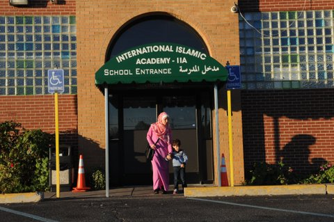 Amani Ramouni, 27, leaves the International Islamic Academy with her son Shadi, 3, in Detroit on November 9, 2016. This Detroit suburb is home to one of the biggest populations of Muslims and Arabs in the United States, and Musid was among many in her community trying to make sense of the brash Republican's election. Across the country, Muslim Americans are now wondering what a Trump presidency might mean, said Hazem Bata, head of the Islamic Society of North America, a national advocacy group. / AFP / Nova SAFO (Photo credit should read NOVA SAFO/AFP/Getty Images)