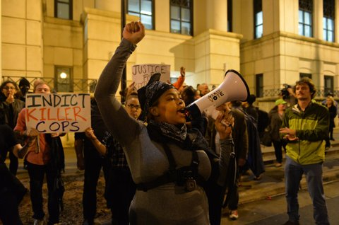 CHARLOTTE, UNITED STATES - NOVEMBER 30: Protesters march through various neighborhoods in Charlotte, North Carolina, USA on November 30, 2016 at midnight during a demonstration following the District Attorney exonerates the police officer involved in the Keith Scott killing, 43, shot and killed by police officers, at an apartment complex near UNC Charlotte. (Photo by Peter Zay/Anadolu Agency/Getty Images)