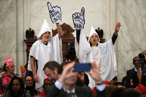 WASHINGTON, DC - JANUARY 10: Protesters wearing white sheets shout at Sen. Jeff Sessions (R-AL) as he arrives for his confirmation hearing to be the U.S. attorney general Senate Judiciary Committee in the Russell Senate Office Building on Capitol Hill January 10, 2017 in Washington, DC. Sessions was one of the first members of Congress to endorse and support President-elect Donald Trump, who nominated him for Attorney General. (Photo by Chip Somodevilla/Getty Images)