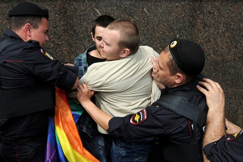 Russian riot policemen detain a gay and LGBT rights activist during an unauthorized gay rights activists rally in cental Moscow on May 25, 2013. AFP PHOTO/ANDREY SMIRNOV (Photo credit should read ANDREY SMIRNOV/AFP/Getty Images)