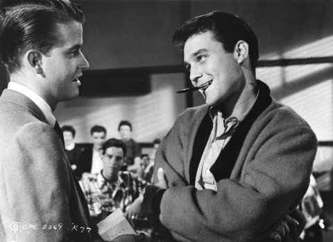 LOS ANGELES - APRIL 1960:  Host of the television show 'American Bandstand' Dick Clark appears in a scene with Michael Callan from the movie 'Because They're Young' which was released in April 1960. (Photo by Michael Ochs Archives/Getty Images)