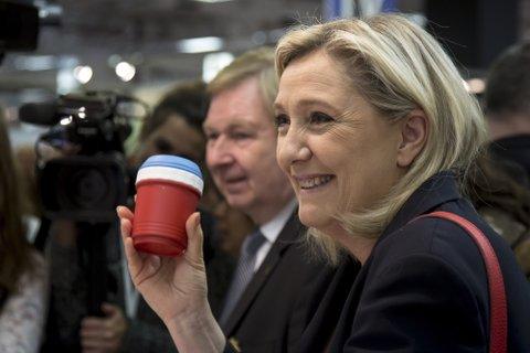 PARIS, FRANCE - MAY 4: Marine Le Pen, Leader of the National Front (FN), far-right political party in France, discovers a product color of the French flag during her visit to the International Lepine Contest on May 4, 2016 in Paris, France.  (Photo by Vincent Isore/IP3/Getty Images)