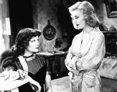 Katharine Hepburn looking up at Ginger Rogers in a scene from the film 'Stage Door', 1937. (Photo by RKO Radio Pictures/Getty Images)
