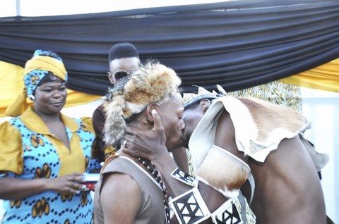 JOHANNESBURG, SOUTH AFRICA - APRIL 6: (SOUTH AFRICA OUT) Tshepo Modisane and Thobajobe Sithole share a kiss on April 6, 2013 at Siva Sungum Hall in Kwadukuza, South Africa. Modisane and Sithole made history as this was the first-ever traditional gay wedding in African Culture. (Photo by Alex Nkosi/Daily Sun/Gallo Images/Getty Images)