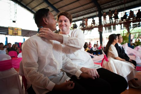 MANILA, PHILIPPINES - JUNE 28:  U.S. national Michael Ellis (R) wipes sweat from his partner Filipino Jesus Bacsal (L) during a mass 'wedding rites' on June 28, 2015 in Manila, Philippines. A small Christian ecumenical group officiated the wedding of one gay and 14 lesbian couples in simple ceremony rites held in a basketball court in the middle class district of Quezon City. Same sex marriage unions are not officially recognized under Philippine laws and is staunchly rejected by the dominant Catholic church in the Philippines. Organizers said todays rites had a special relevance following the landmark U.S. Supreme Court ruling on gay marriage and emboldens other countries to adopt a more tolerant stance on same sex unions.  (Photo by Dondi Tawatao/Getty Images)