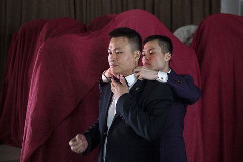 CHANGSHA, CHINA - MAY 17:  (CHINA OUT) Sun Wenlin (R) and his same-sex partner Hu Mingliang hold wedding in Changsha on May 17, 2016 in Changsha, Hunan Province of China. Furong District people's court judged China's first same-sex marriage case on April 13 and the plaintiffs Sun Wenlin and Hu Mingliang lost the case. Sun and Hu held their wedding in Changsha on May 17, and had planned to hold 100 same-sex weddings for gay couples.  (Photo by VCG/VCG via Getty Images)