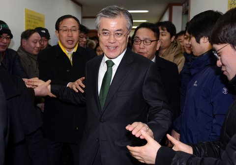 South Korean presidential candidate Moon Jae-In (C) of the main opposition Democratic United Party, leaves after a news conference declaring his rival's victory at the party headquarters in Seoul on December 19, 2012. South Korea elected its first female president on December 19, handing a slim but historic victory to conservative ruling party candidate Park Geun-Hye, daughter of the country's former military ruler.   AFP PHOTO/DONG-A ILBO        (Photo credit should read -/AFP/Getty Images)