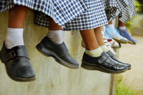 School children hanging out outside their roon