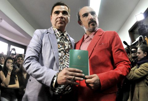 MONTEVIDEO, URUGUAY - AUGUST 22:  Sergio Miranda and Rodrigo Borda show their marriage certificate during his wedding as the first gay couple to get married in Uruguay on August 22, 2013 in Montevideo, Uruguay. Uruguay is the twelfth country in the world to allow same-sex marriage, and the second in Latin America after Argentina did back in 2010. (Photo by Dante Fernandez/LatinContent/Getty Images)