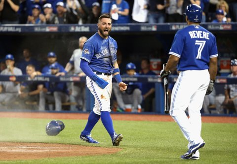 TORONTO, ON - OCTOBER 19:  Kevin Pillar #11 of the Toronto Blue Jays celebrates with Ben Revere #7 of the Toronto Blue Jays after scoring a run in the second inning against the Kansas City Royals during game three of the American League Championship Series at Rogers Centre on October 19, 2015 in Toronto, Canada.  (Photo by Tom Szczerbowski/Getty Images)